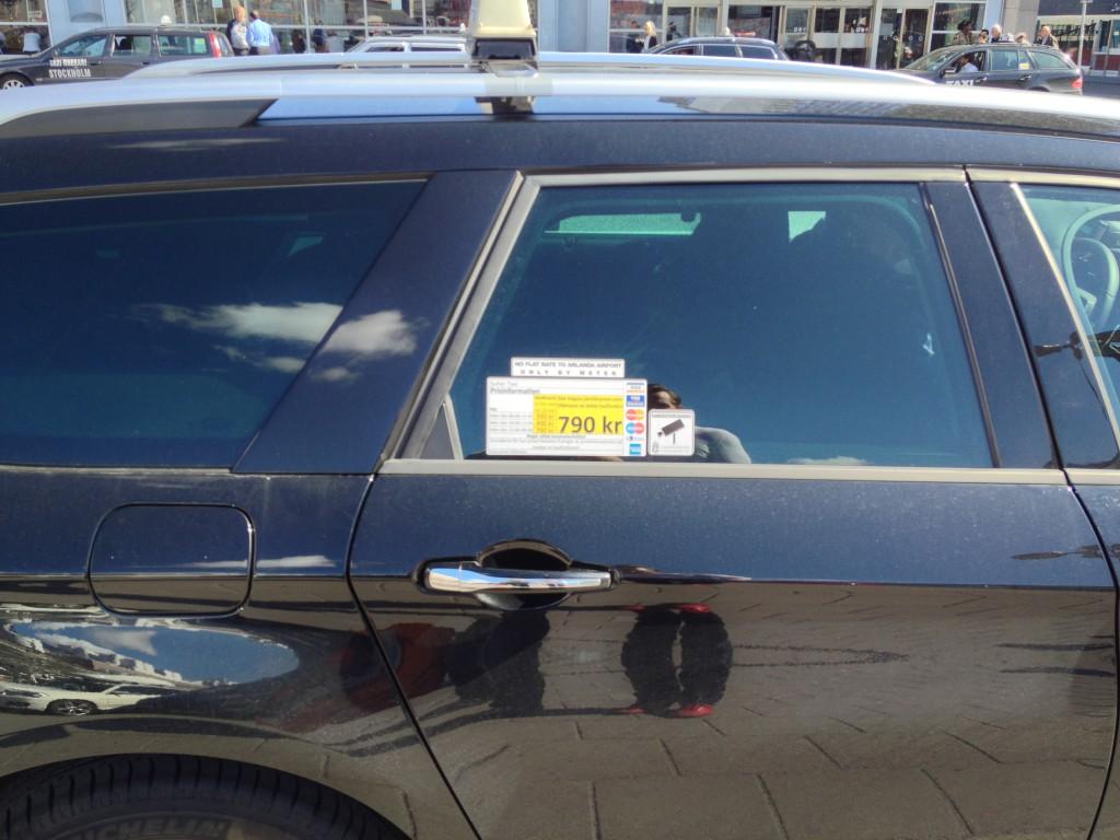 A price comparison sticker on a Swedish taxi cab